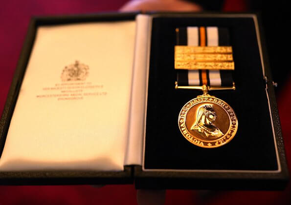 At Buckingham Palace, Lord Prior of the Order of St John, Professor Mark Compton presented the first ever golden medal to the Queen