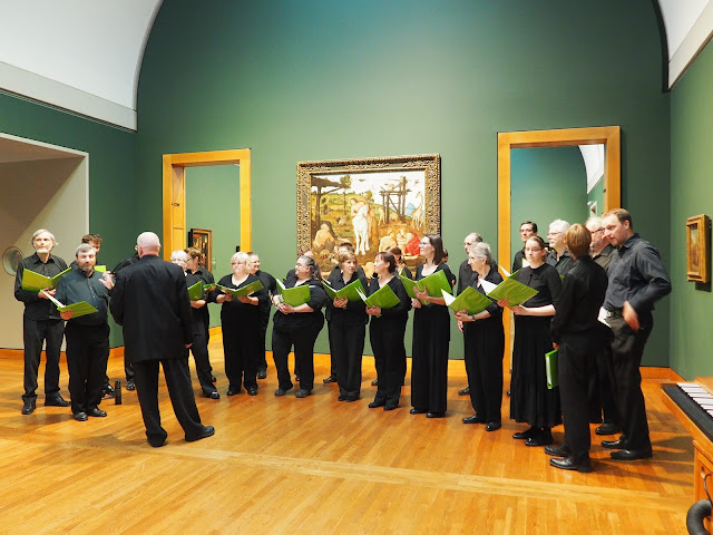 Stairwell Carollers get ready to sing in a Renaissance room - photo credit Music and Beyond
