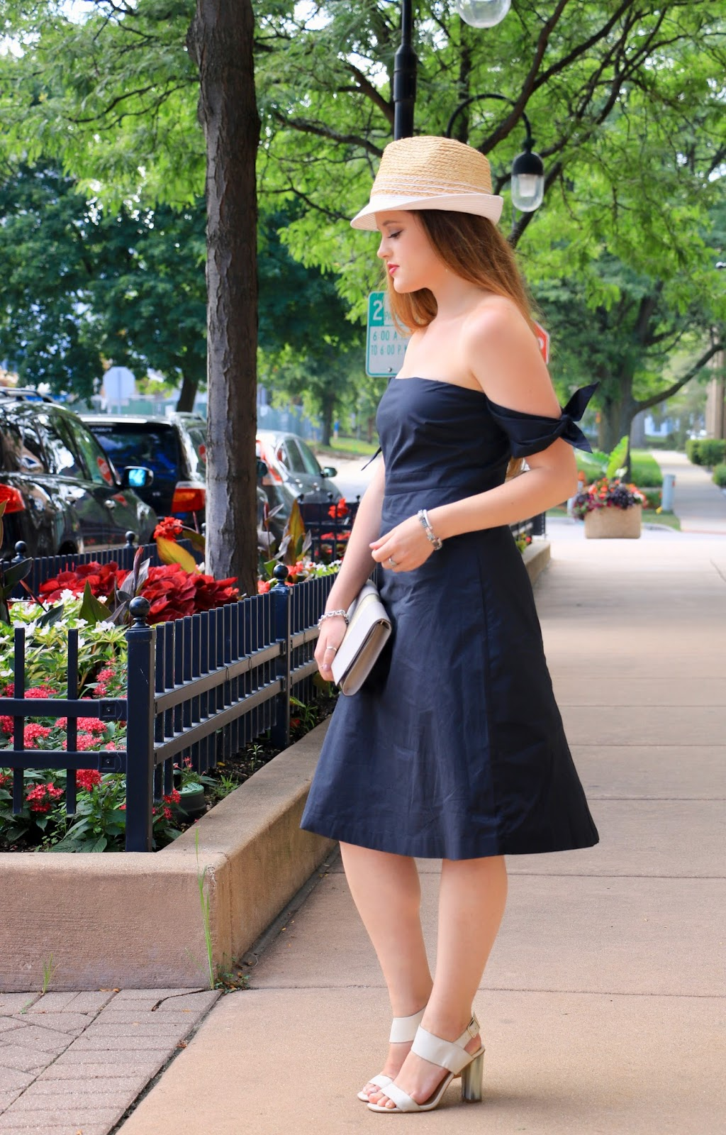 Fashion blogger Kathleen Harper of Kat's Fashion Fix wearing an off-the-shoulder black dress