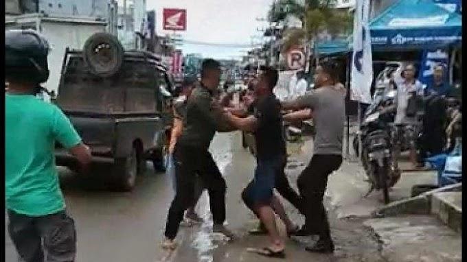Viral, 2 Oknum Polisi Keroyok 1 Anggota TNI