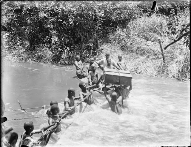 Wading a river. E.O. Teale Collection
