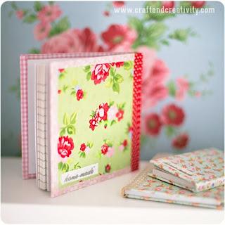 http://craftandcreativity.com/blog/2013/09/18/fabriccoveredbooks/