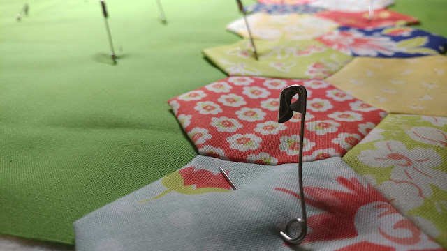 EPP hexies in Coney Island fabrics by Fig Tree & Co. for Moda