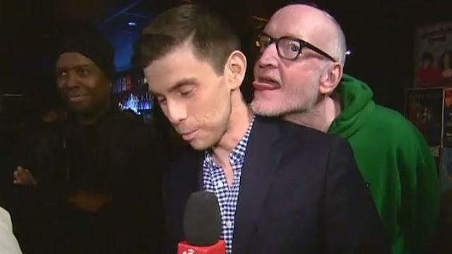Reporter files complaint after comedian appears to lick him during TV hit