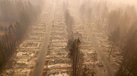In this aerial photo, a burned neighborhood is seen in Paradise, California on November 15, 2018. (Credit: Josh Edelson / AFP / Getty Images) Click to Enlarge.