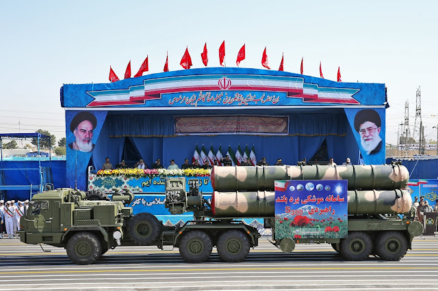In front of the portraits of supreme leader Ayatollah Ali Khamenei, right, and late revolutionary founder Ayatollah Khomeini, left, a long-range, S-300 missile system is displayed by Iran's army during a military parade marking the 36th anniversary of Iraq's 1980 invasion of Iran, in front of the shrine of late revolutionary founder Ayatollah Khomeini, just outside Tehran, Iran, Wednesday, Sept. 21, 2016 / AP PHOTO/ EBRAHIM NOROOZI