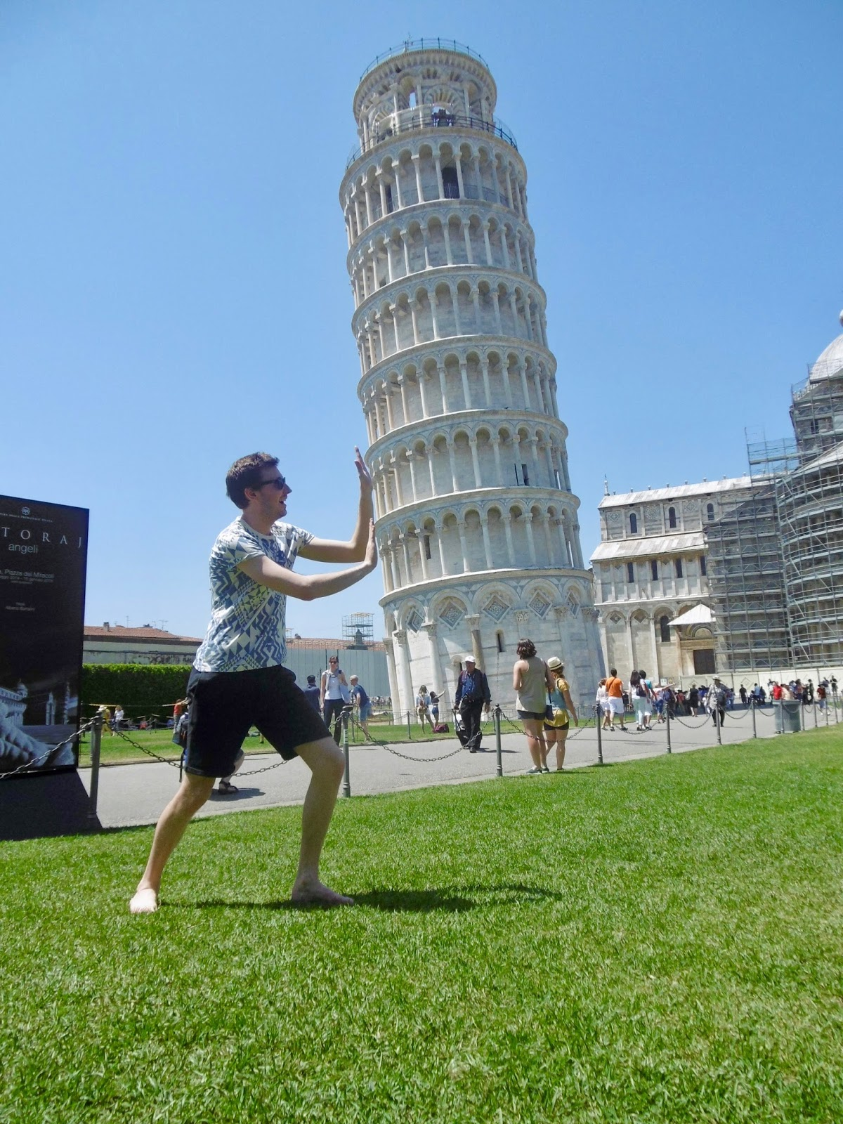 Pretending to hold up the leaning tower of Pisa ,  Cal McTravels