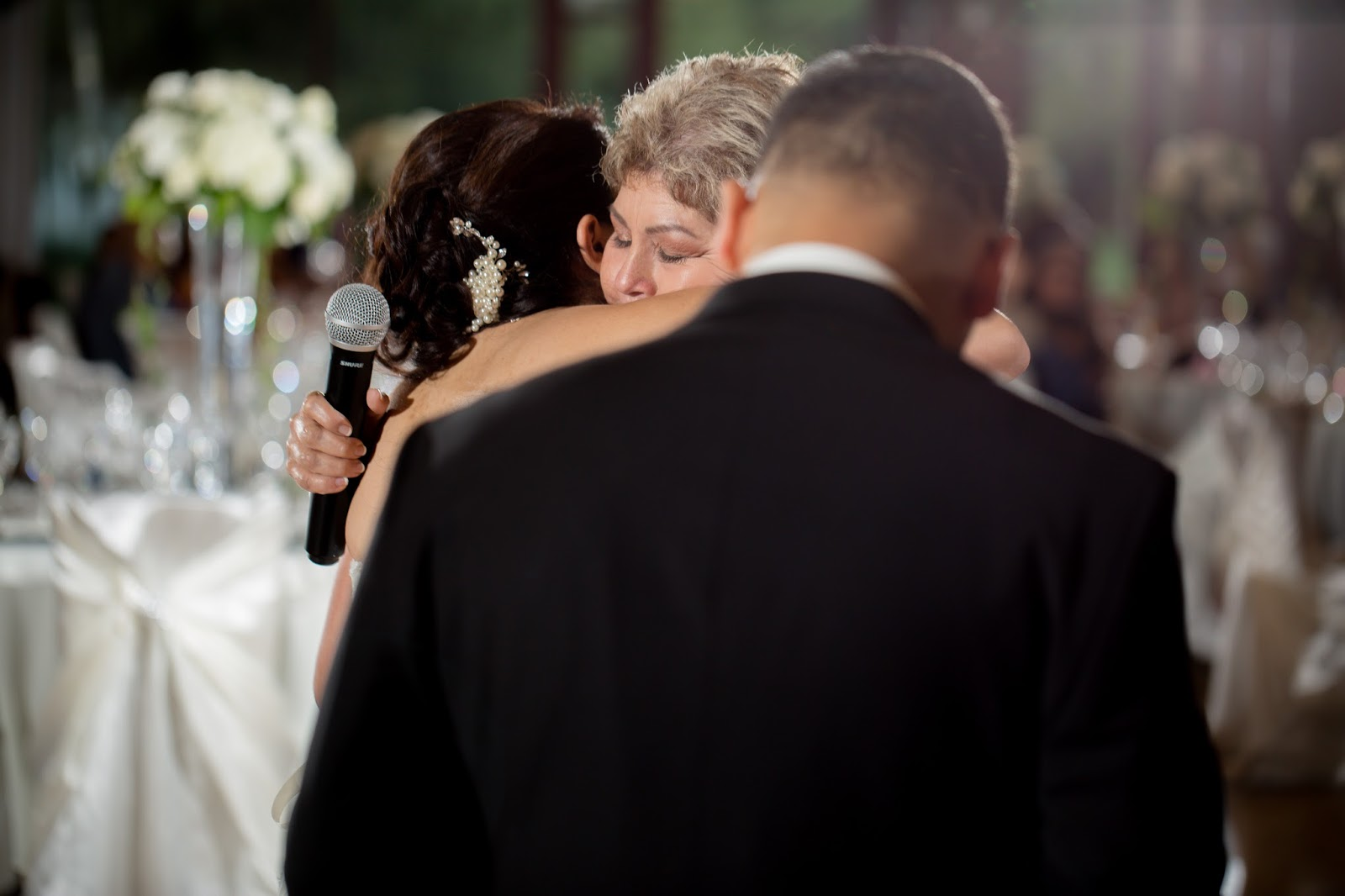 Mother of Groom and Bride in loving, accepting embrace
