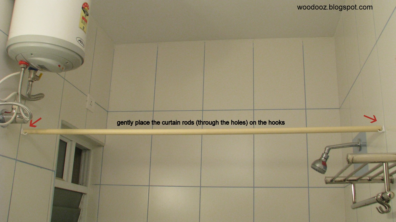 Place The Curtain Rod On Hooks