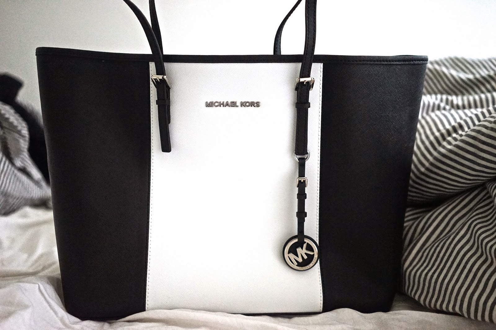 Michael Kors black and white handbag