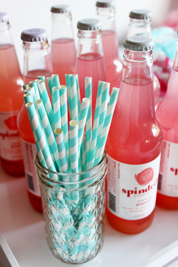 Pink lemonade and blue striped straws for gender-reveal party