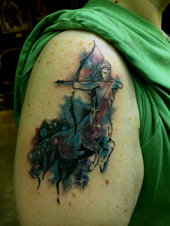 Watercolor Sagittarius zodiac tattoo design on arm