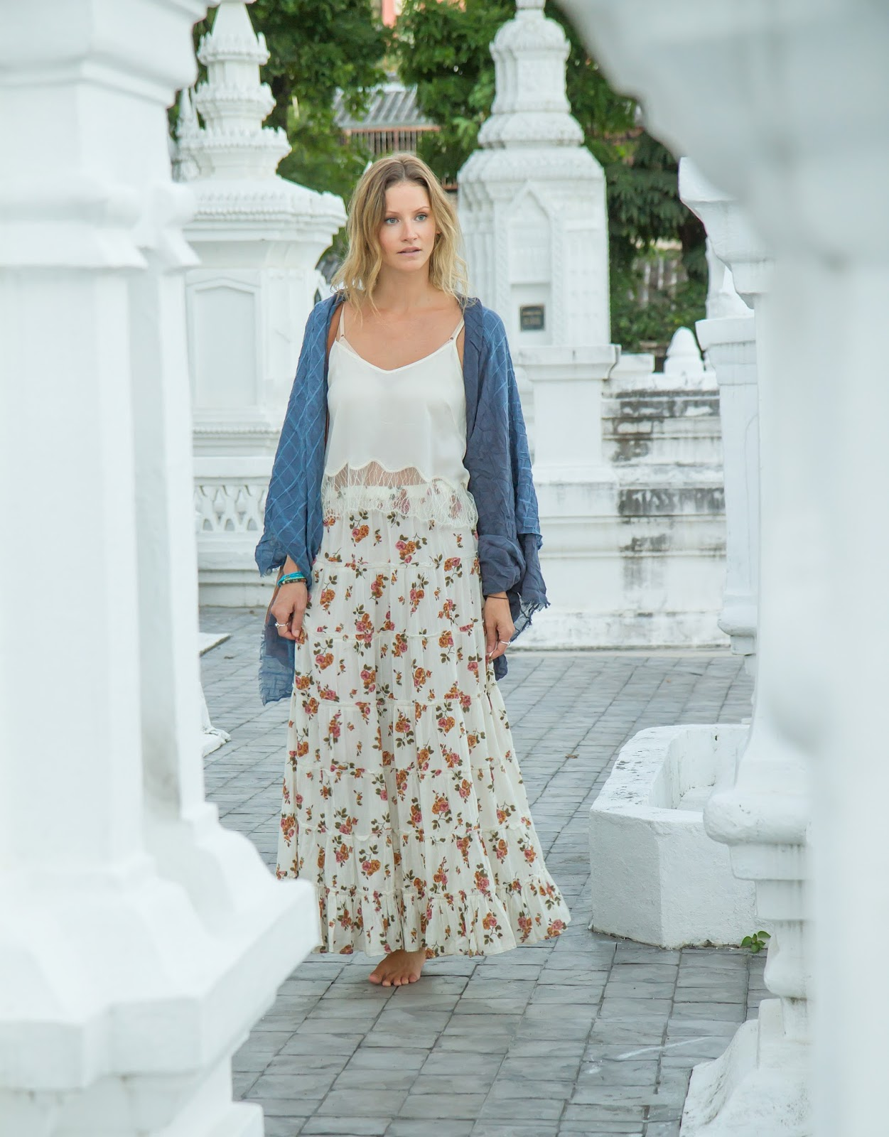 Fashion and travel blogger, Alison Hutchinson, is wearing a long skirt and scarf to cover up at the temples in Chiang Mai, Thailand