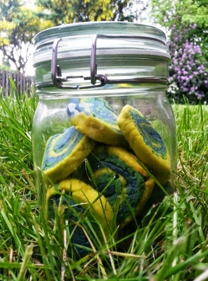 Swirly Rainbow cookies in blue green and yellow in mason kilner jar