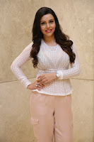 Kyra Dutt in Tight White Top Trousers at Paisa Vasool audio success meet ~  Exclusive Celebrities Galleries 005.JPG