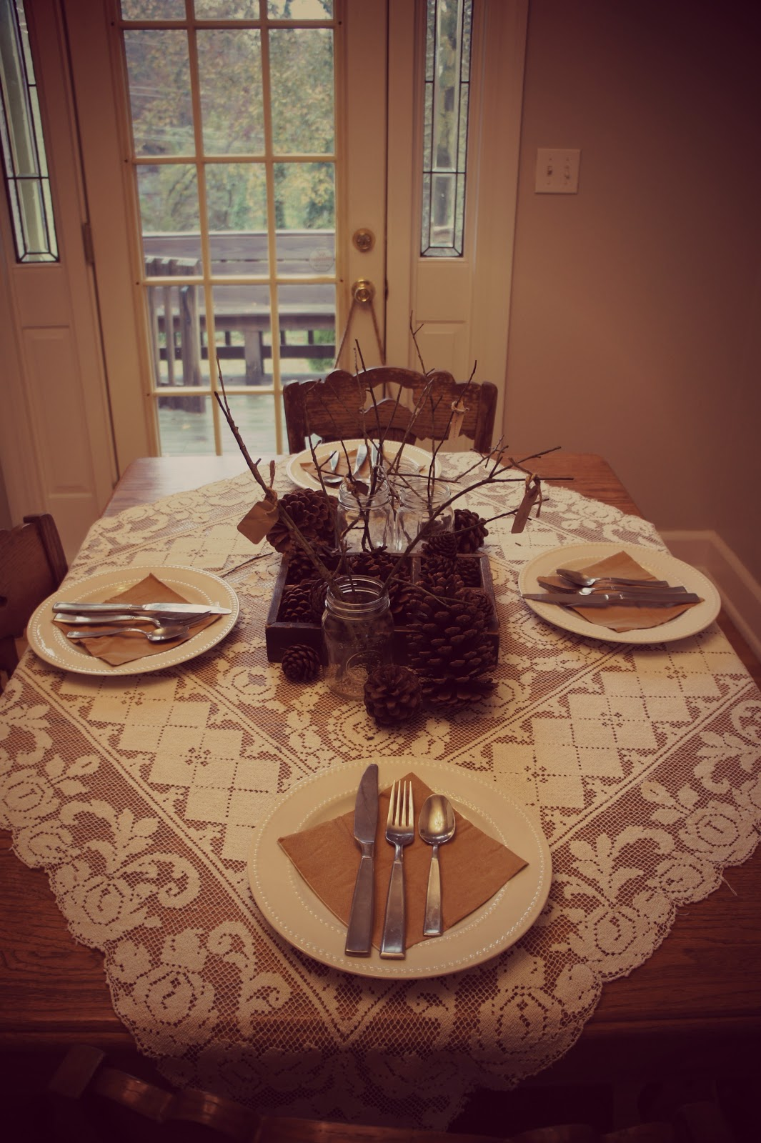 I found small branches and twigs that I added to Dollar Tree Mason jars and I also scattered pine cones that Iu0027ve collected to the setting. & Frugal Foodie Mama: Setting a Gorgeous Thanksgiving Table on the Cheap