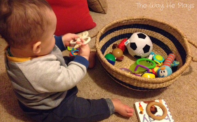 Baby playing with treasure basket