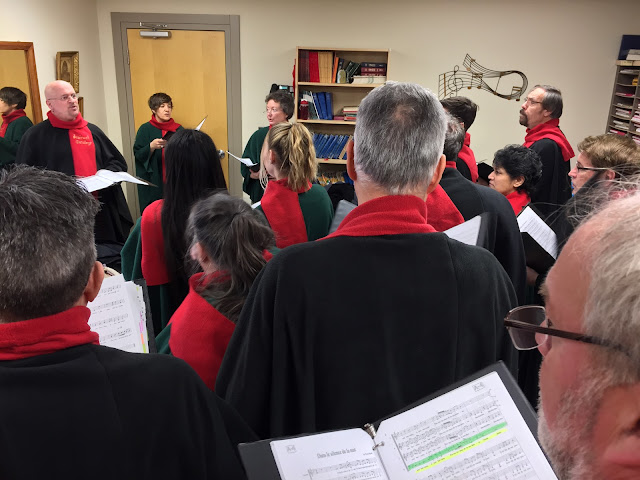 Pierre warms the choir up before the Dec 9, 2018 performance