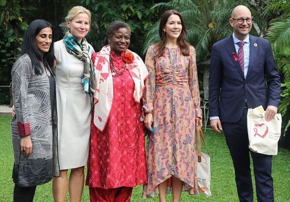 Crown Princess Mary wore sil dress by H&M. Minister Rasmus Prehn and Executive Director UNFPA Natalia Kanem