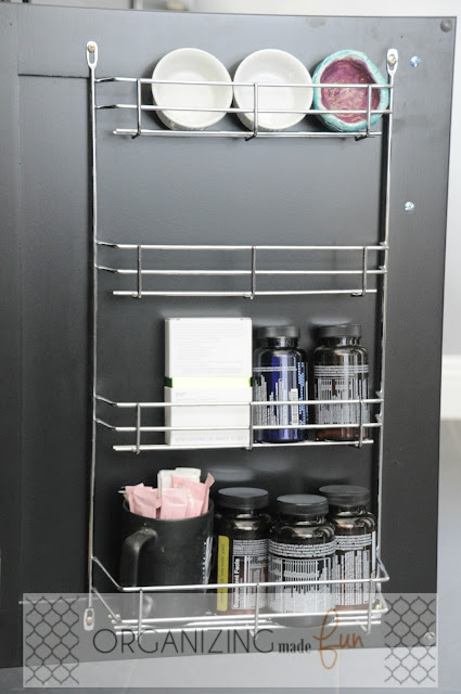 Back of cabinet door to hold supplements :: OrganizingMadeFun.com