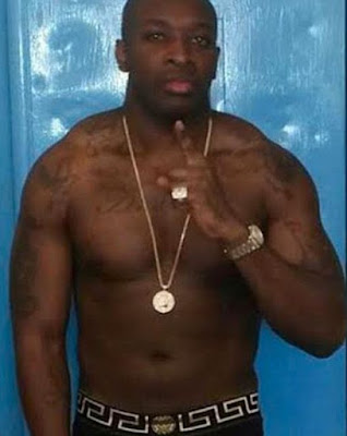 Nigerian drug gangster flouts prison rules to show off £3,000 Rolex and designer shirt
