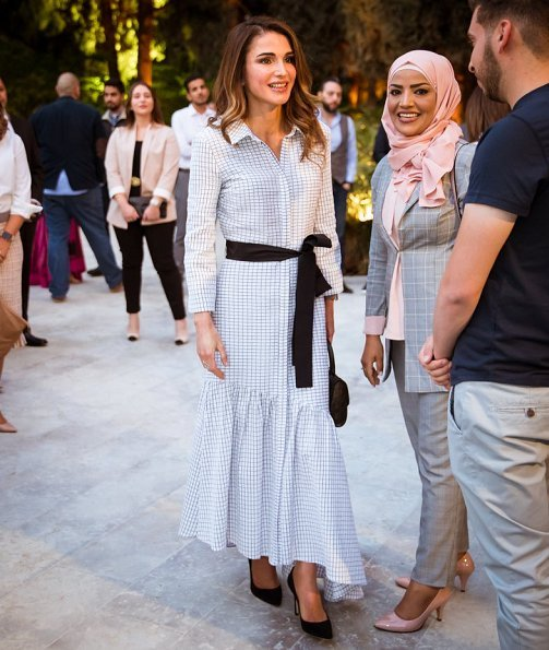 Queen Rania of Jordan held an Iftar banquet for Jordanian youth at Basman Palace wore asymmetric belted shirt dress, she carried Louis Vuitton bag