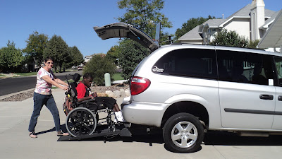 Now Penny can wheel Isaac into the adapted van rather than lift him into a seat.