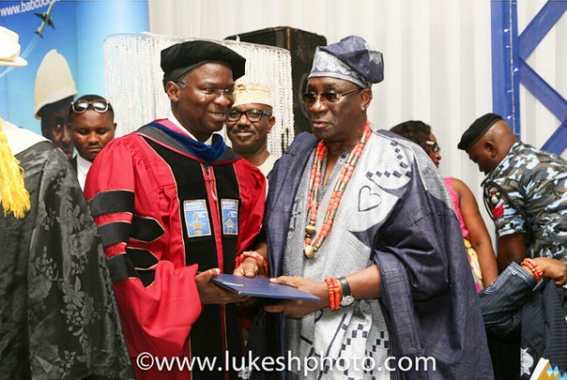 Fashola And His Son At His Honorary Degree Conferment Ceremony At Babcock Uni Yesterday