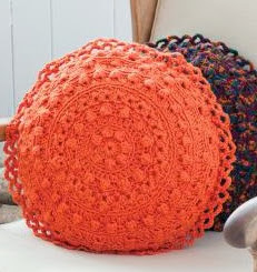 http://www.bestfreecrochet.com/2012/04/17/free-crochet-pattern-puff-stitch-round-pillows-from-redheart-com-107/