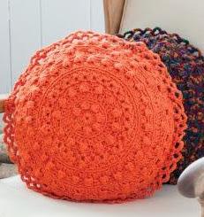http://www.bestfreecrochet.com/2012/04/17/free-crochet-pattern-puff-stitch-round-pillows-from-redheart-com-107/