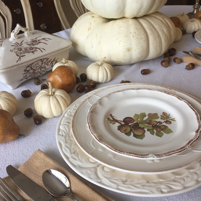 fall tablescape fig plates pears and white pumpkins