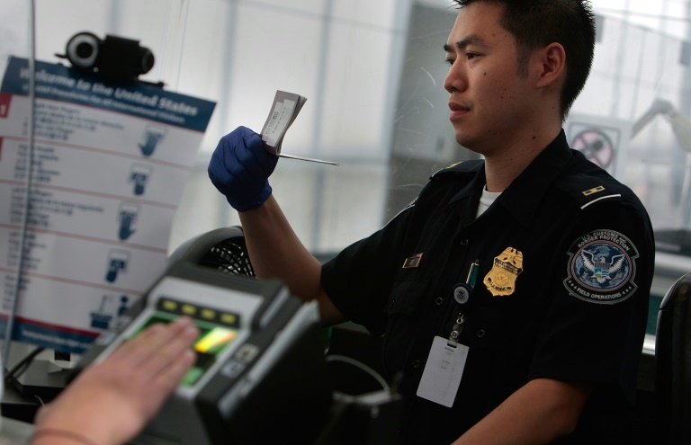 The New York Times reported that airport officials began detaining travelers following the president's executive order closing America's borders to refugees