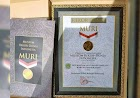 Penggunaan pakaian adat khas Melayu Telok Belanga dan Baju Kurung tercatat sebagai rekor Museum Rekor-Dunia Indonesia (MURI)