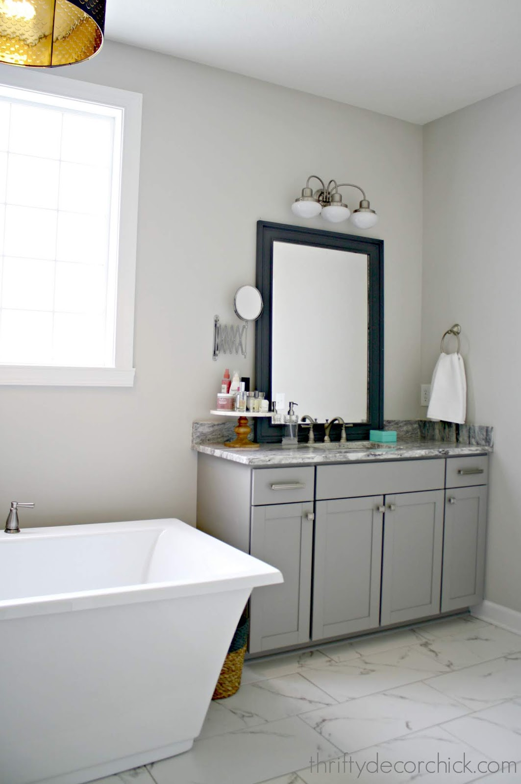 Tall light gray vanities in bathroom
