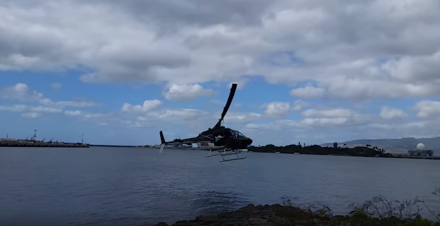 A helicopter. which was carrying tourists, fell into water from sky at Pearl Harbour on Thursday.  According to the eyewitnesses, who took videos, the Bell 206 chopper was flying normally, but started descending. It continued to do so till it hit the water  and sank.  The incident occurred at the Pearl Harbor Visitor Center.