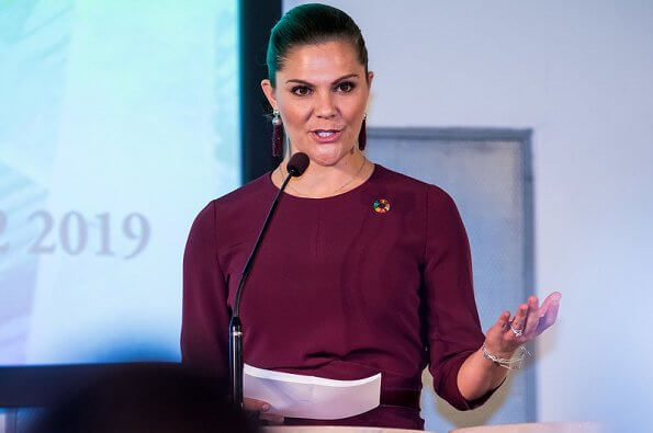 Crown Princess Victoria wore Andiata Kamille trousers and kiana blouse in burgundy, and Odnala wool coat in pink