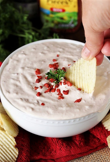 Dipping a Chip in Homemade Bacon Horseradish Dip Image