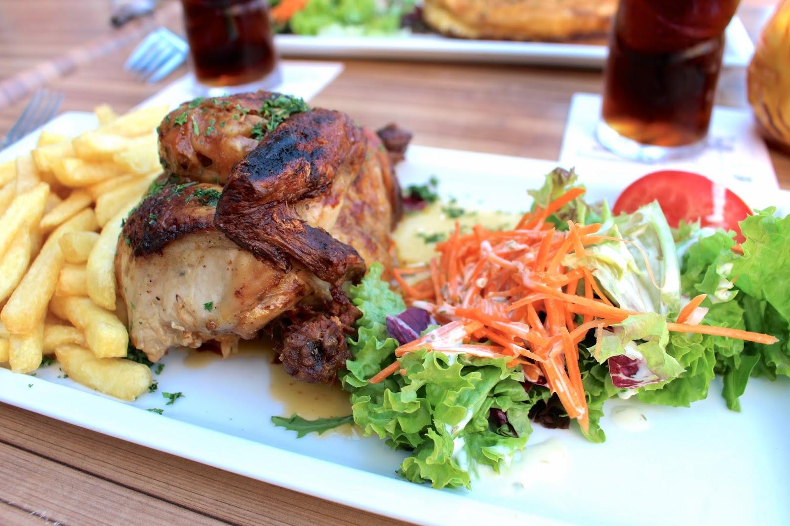 Half roast chicken at la bella vue bruges belgium