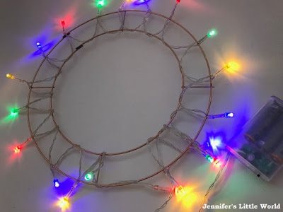 Yarn wrapped light up wreath Christmas decoration