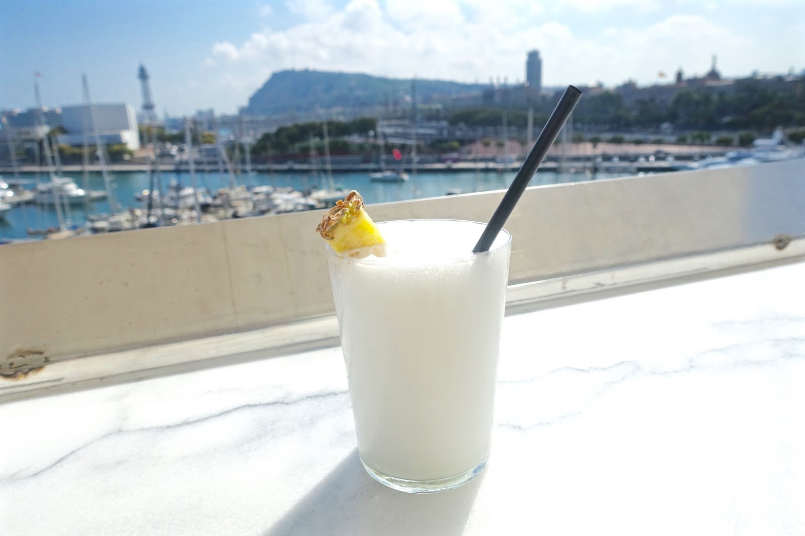 pina colada cocktail at Restaurante 1881 per Sagardi terrace