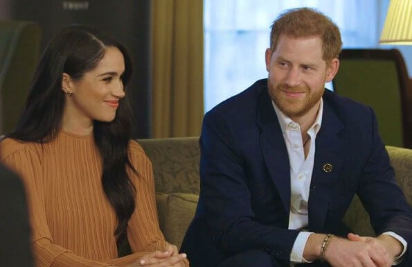 Meghan Markle wore Preen by Thornton Bregazzi Glenda asymmetric plissé georgette midi dress. Prince Harry