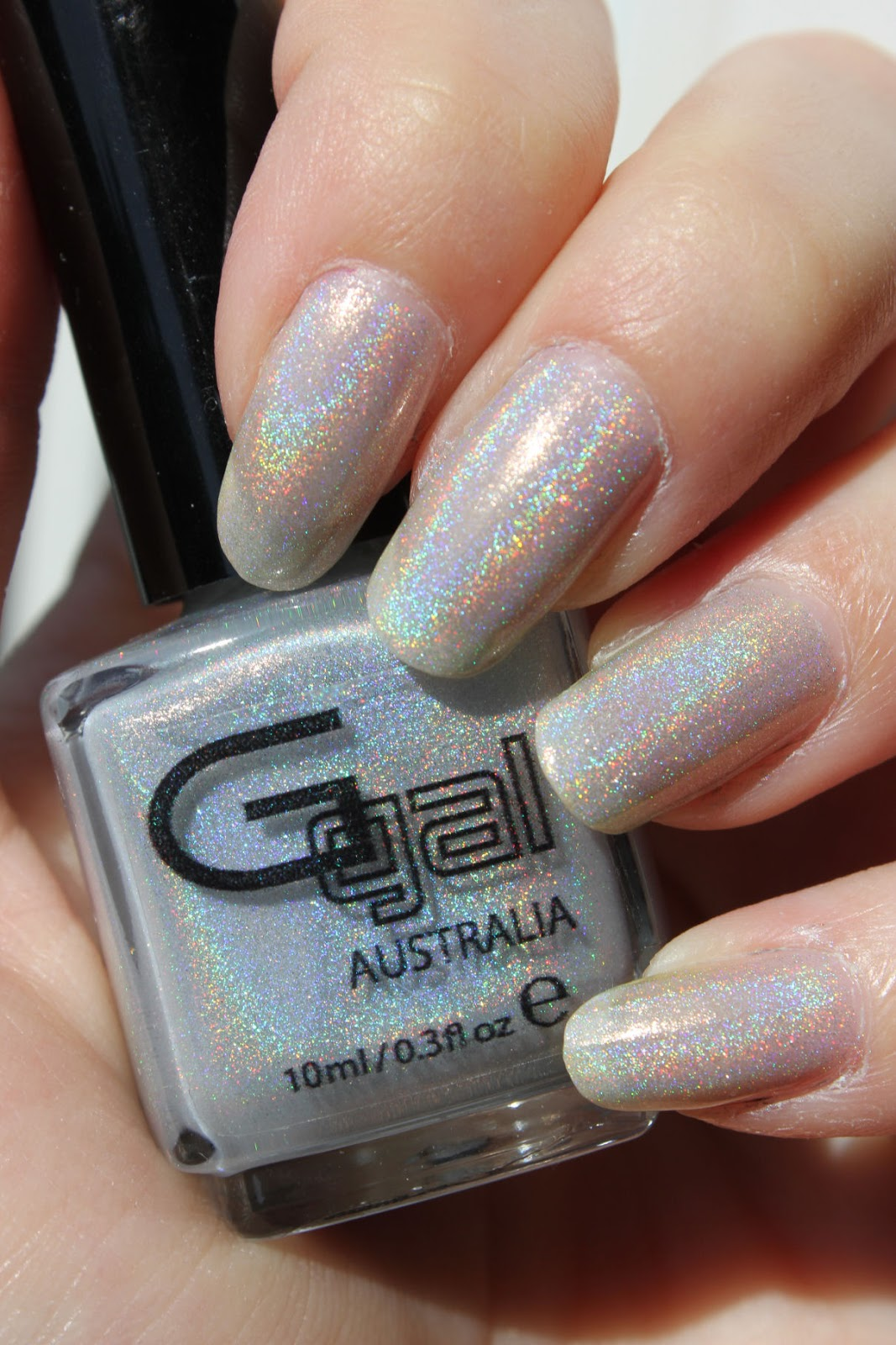 http://lacquediction.blogspot.de/2015/04/glittergal-light-as-feather-dupetest.html