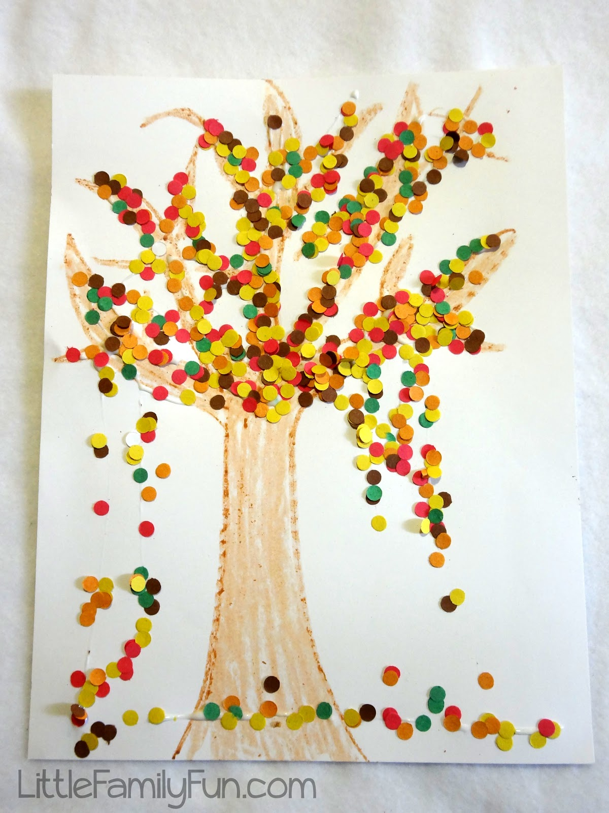 """Pop some popcorn, shake it in some paint, and you've got yourself some colourful """"leaves"""" for this adorable Popcorn Fall Tree Craft. This is a fun and easy fall craft for toddlers and preschoolers and great for both large-motor and fine-motor skills."""