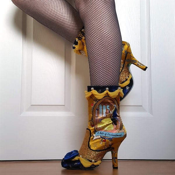 side view of legs wearing yellow brocade boots with disney beauty and the beast image on side