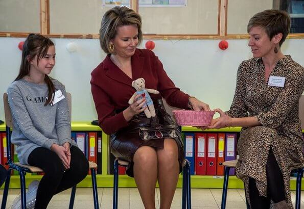 Queen Mathilde of Belgium visited a Horticultural School (Tuinbouwschool) in Melle. brown leather skirt silk blouse