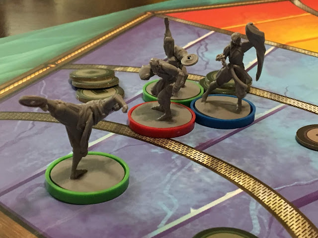 Bolin does his best to hold off the Wolfbats. Legend of Korra: Pro-Bending Arena board game review by Benjamin Kocher. Game by IDW Games, photo by Benjamin Kocher