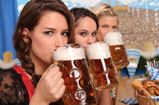 3 girls drinking Steins at Oktoberfest