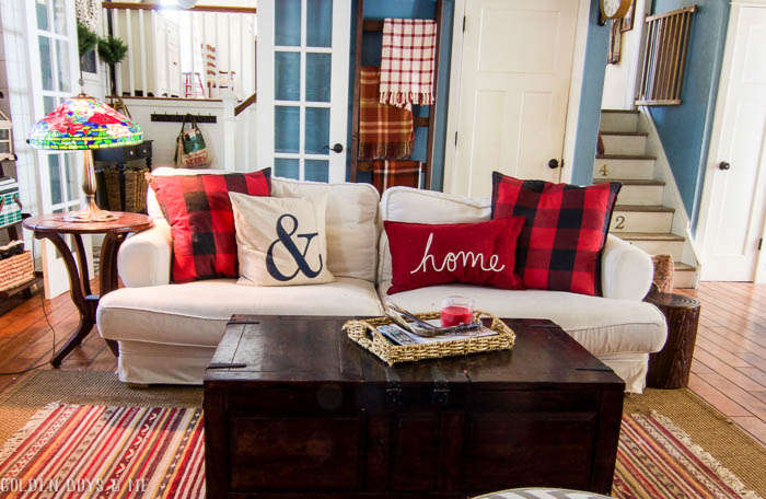 Winter family room with Pottery Barn plaid pillows, stained glass lamp and DIY quilt ladder