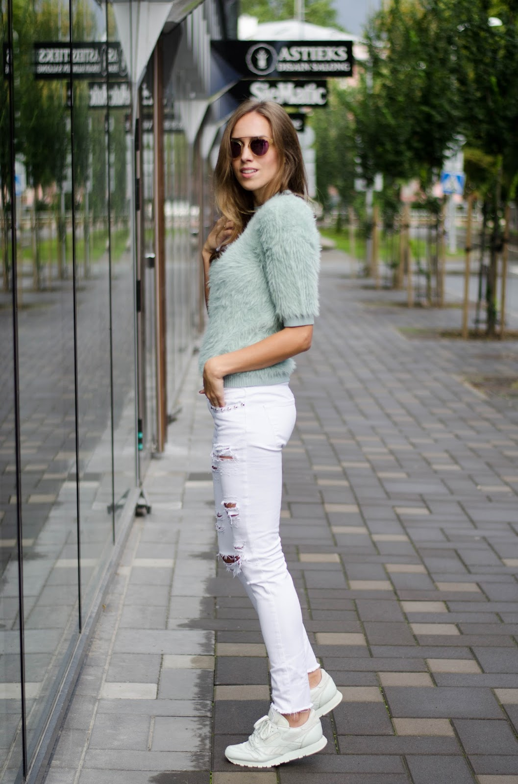 mint fluffy sweater white skinny jeans sneakers outfit
