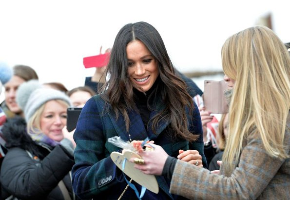 Meghan Markle wore a double-breasted tartan wool-blend coat by Burberry during Edinburgh visit. Meghan carried Strathberry Mini crossbody bag